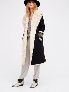Boiled Wool Faux Shearling Coat | Gorgeous faux shearling coat featuring decorative etched button closures and beautifully embellished sleeve cuffs. Hidden side pocket details. Irresistibly soft and cozy.