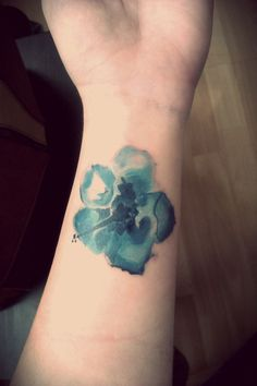 Dont really like tattoos but I like this design. watercolor tattoo-tiger lily, smaller