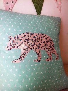 Handmade floral bear silhouette cushion with bow.
