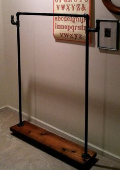 Second bedroom clothes hanger ... or cool laundry rack .... great coat rack for the back door area