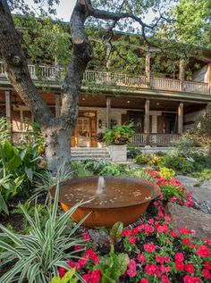 A fountain made from a Louisiana sugar kettle (used in traditional sugar production) babbles a welcome to visitors to this Dallas home