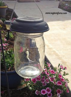 Inexpensive DIY Mason Jar Solar Lights - My Turn for Us - I love yard lights twinkling in the summer night illuminating soft romantic areas around the yar - Mason Jar Solar Lights, Mason Jar Light Fixture, Hanging Mason Jars, Mason Jar Lighting, Jar Lights, Solar Light Crafts, Diy Solar, Mason Jar Crafts, Mason Jar Diy