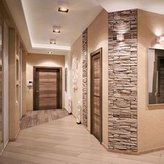 In recent years, it has become quite popular to decorate the walls in the corridor with decorative bricks. And this is no accident, Style At Home, Faux Stone Walls, Flur Design, Bedroom False Ceiling Design, Living Room Decor Inspiration, Hallway Designs, Luxurious Bedrooms, Home Decor Kitchen, Modern House Design