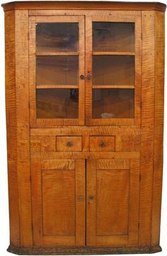 An antique Tiger Maple corner cupboard, with glass doors upper and blind doors lower, two drawers and two false drawe. Maple Furniture, Primitive Furniture, Country Furniture, Antique Furniture, Furniture Decor, Primitive Antiques, Primitive Country, Antique Cupboard, Antique Farmhouse