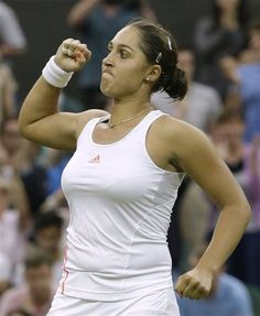Tamira Paszek of Austria gestures after winning a first round women's singles match against Caroline Wozniacki of Denmark at the All England Lawn Tennis Championships at Wimbledon, England, Wednesday, June 27, 2012. (AP Photo/Kirsty Wigglesworth)