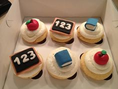 Teacher theme cupcake toppers, set of 12 (4 of each design) for $18 via Etsy.