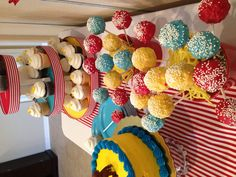 """Rice Krispy Treat """"cake pops"""" in red, blue and yellow"""