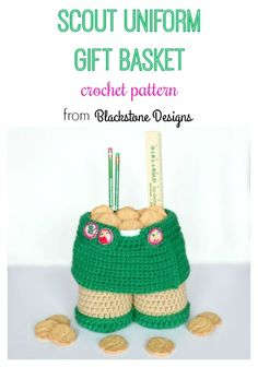 "Scout Uniform Gift Basket crochet pattern from Blackstone Designs This basket can be used for leader appreciation gifts, office supply holder for your desk, scout birthday gifts or party centerpieces, and even a place to store patches, pins, or other scout goodies. Wouldn't this look cute on the table of your end-of-year party?! The best part: you can pin swaps and other pins to the skirt! Measure approx. 8"" x 8"" Skill Level: Easy #scouts #girlscouts #leadergift #SWAPS #pins #badges #basket"