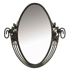 A FRENCH ART DECO WROUGHT-IRON AND BEVELL-EDGED MIRROR CIRCA 1930