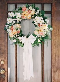 Add romance by adding a long cascading bow to the wreath