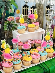 Loving the flamingo and pineapple cupcakes at this summer luau!  See more party ideas and share yours at CatchMyParty.com  #catchmyparty #partyideas #luau #summerparty #girlbirthdayparty #luaucupcakes