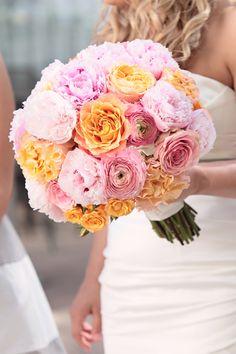 gorgeous bouquet of ruffly orange + pink flowers | Kristin Vining #wedding