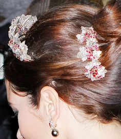 The Danish Ruby Parure Tiara worn primarily by Crown Princess Mary of Denmark. This tiara was originally longer and taller (by a leaf or two) however, in these pictures you can see that it was eventually shortened and the top leaf was removed. In the picture below it is showing a piece that was removed and now are used as hair pins to complete the parure