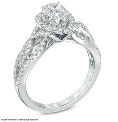 side view vintage halo diamond engagement ring in 14k white gold