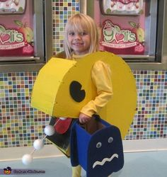 Little girl's Pac-Man costume, with scared ghost candy bucket, from a 2013 Halloween Costume Contest