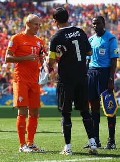 SAO PAULO, BRAZIL - JUNE 23:  Arjen Robben of the Netherlands and Claudio Bravo of Chile shake hands prior to  the 2014 FIFA World Cup Brazil Group B match between the Netherlands and Chile at Arena de Sao Paulo in Sao Paulo, Brazil.