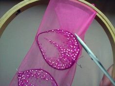 Embroidery...edge has wire or cording under it...
