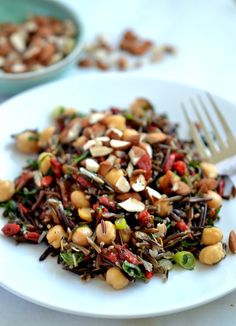 Chickpea, Goji & Wild Rice Salad  3/4 C Wild rice 1/2 C Goji berries 1 C Cooked chickpeas 2 Green onions, thinly sliced 1/4 C Chopped mint 2T Chopped basil 1-1/2 T Olive oil 1-1/2 T Apple cider vinegar Zest of 1/2 a lemon Salt and pepper, to taste 1/4C Almonds, lightly toasted and chopped