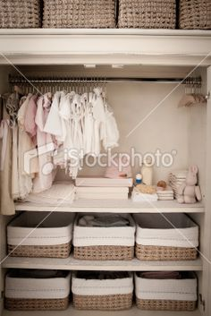 I really want to add some low shelves, since baby clothes obviously don't need so much hanging room. Could do baskets separated by size for folded items? Maybe just do the shelves on one half, and leave the other half open, since her closet is much wider than this one...