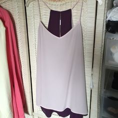 Express reversible tank top Express reversible racerback tank top can go from pink to a wine color in seconds! Good deal for a two in one tank top! Express Tops Tank Tops
