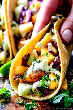 Mind blowing Blackened Fish Tacos exploding with flavor from a quick fish marinade and the most flavorful spice rub complimented by Pineapple Cucumber Slaw!