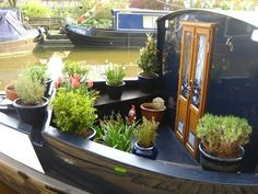 Like the double doors and potted garden.Like the double doors and potted garden. Living On A Boat, Tiny Living, Canal Boat Interior, Barge Boat, Trailers, Narrowboat Interiors, Houseboat Living, Floating House, Waterfront Property