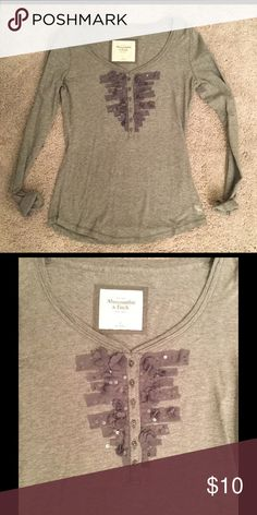 Abercrombie and Fitch Gray Embellished Henley S Abercrombie and Fitch Gray Embellished Henley Size S. Brand new, never been worn before!!! Abercrombie & Fitch Tops
