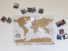 Vvoici ma mappemonde à gratter, agrémentée de mes photos de voyage façon polaroïd !
