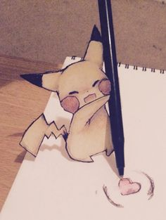 Pikachu is drawing... and looking adorable while doing it:)