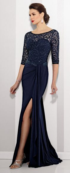 This beautiful Cameron Blake jersey sheath dress features lace illusion 3/4 length sleeves and a sweetheart bodice. Available in Navy Blue & Claret.