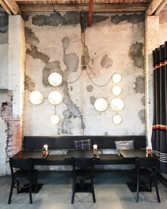 restaurant dining booth and wall light fixture photographed by @petitepassport on instagram. / sfgirlbybay