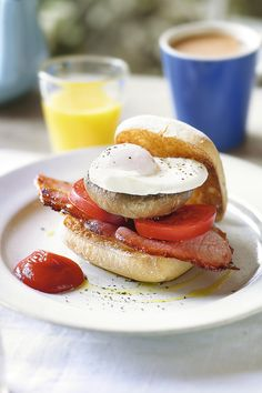 For a quick and delicious breakfast snack, layer grilled bacon, tomatoes and mushroom with a soft poached egg and a dollop of ketchup.