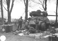 This M4A1 76w is from A Company, 20th Tank Battalion , 20 Armored Division. They are on the outskirts of Cailly, France on February 24th, they had arrived in country a few days before and had not seen combat yet. The crew is unpacking and taking inventory of all the gear issued with the tank