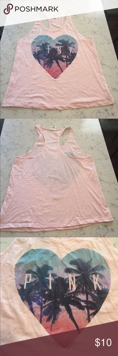 Victoria's Secret PINK Graphic Tank This Victoria's Secret PINK Graphic Tank has a super cute tropical heart graphic that has pink in lettering! 🌴❤️ Super soft and comfortable! Light pink colored cotton-like material. Great for Summer! Worn Once. Size Large. PINK Victoria's Secret Tops Tank Tops