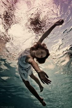 Look at that one bubble escaping.  Taking her last breath?  Underwater Photography by Elena Kalis
