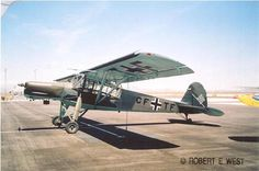 """Fieseler (Fi-156) / Storch: The long legs of the main landing gear contained oil-and-spring shock- absorbers that had a travel of 40 cm  allowing the aircraft to land on comparatively rough and uneven surfaces - this was combined with a """"pre-travel"""" distance of 20 cm, before the oleos began damping the landing gear shock. In flight, the main landing gear legs hung down, giving the aircraft the appearance of a long-legged, big-winged bird, hence its nickname, Storch."""