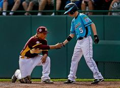 Nashville, Tenn.'s Robert Hassell consoles Corpus Christi, Texas pitcher Jesus Ortiz after he was taken out as pitcher during the fourth inning of an elimination game at the Little League World Series in South Williamsport, Pa. Saturday. (Gene J. Puskar/AP)