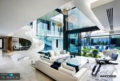 Contemporary Living Room with Custom staircase, Concrete floors, Pendant Light, Shades of light silver circles pendant light