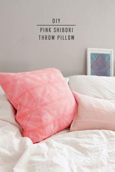 DIY Pink Shibori Throw Pillow by Sugar & Cloth, an award winning DIY and home decor blog.