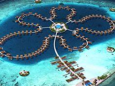 Casas de veraneio dispostas em forma de flor já estão à venda (Foto: Divulgação)  http://g1.globo.com/turismo-e-viagem/noticia/2013/01/maldivas-constroi-hotel-flutuante-em-ilha-com-formato-de-estrela.html