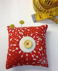 Choose a favorite fabric and make this quick-to-sew pincushion. Stack two buttons to top of your cute creation for bright accents. Make a bunch for your sewing friends or keep one handy for on-the-go sewing.