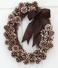 DIY pine cone wreath:: red ribbon for Christmas