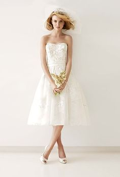 Style MS251047, tea-length gown with diagonal banding skirt, $700, Melissa Sweet Collection exclusively for David's Bridal
