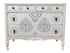 This beautifully constructed solid wood Chest of Drawers is made of mahogany and walnut (stamp on back). Painted white with beautiful light blue stencils on the drawers, top and sides, this piece will brighten any room. The 4 dovetail drawers have been lined with new contact paper and slide easily.