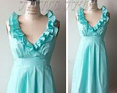 aqua cotton bridesmaid dress via Etsy.. . . Don't know about the ruffles but I think the color is perfect