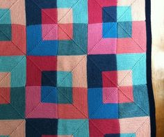 Mitred Squares - - interesting quilt-like color layout (K)