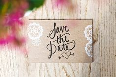 Rustic postcard save the dates with stamped lettering on recycled brown card