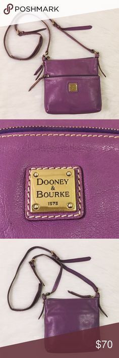 Dooney & Burke Leather crossbody Dooney & Burke purple leather crossbody. Measurements are shown in pictures. Very spacious, with 2 zip pockets, an interior zip pocket, and 2 additional pockets for cell phone or other cosmetics. Measurement for adjustable strap is shown at maximum length in photograph. Inside key hook. This is a very spacious crossbody that has been used a few times. The interior and exterior were just cleaned. Feel free to ask any additional questions! Dooney & Bourke Bags…