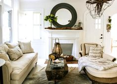 I love the natural fibers and materials used in this light filled eclectic living room in a Tampa cottage.
