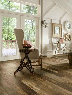 Laminate floor with a reclaimed rustic look by Armstrong Architectural Remnants in Woodland Reclaim. Amazing color and texture!